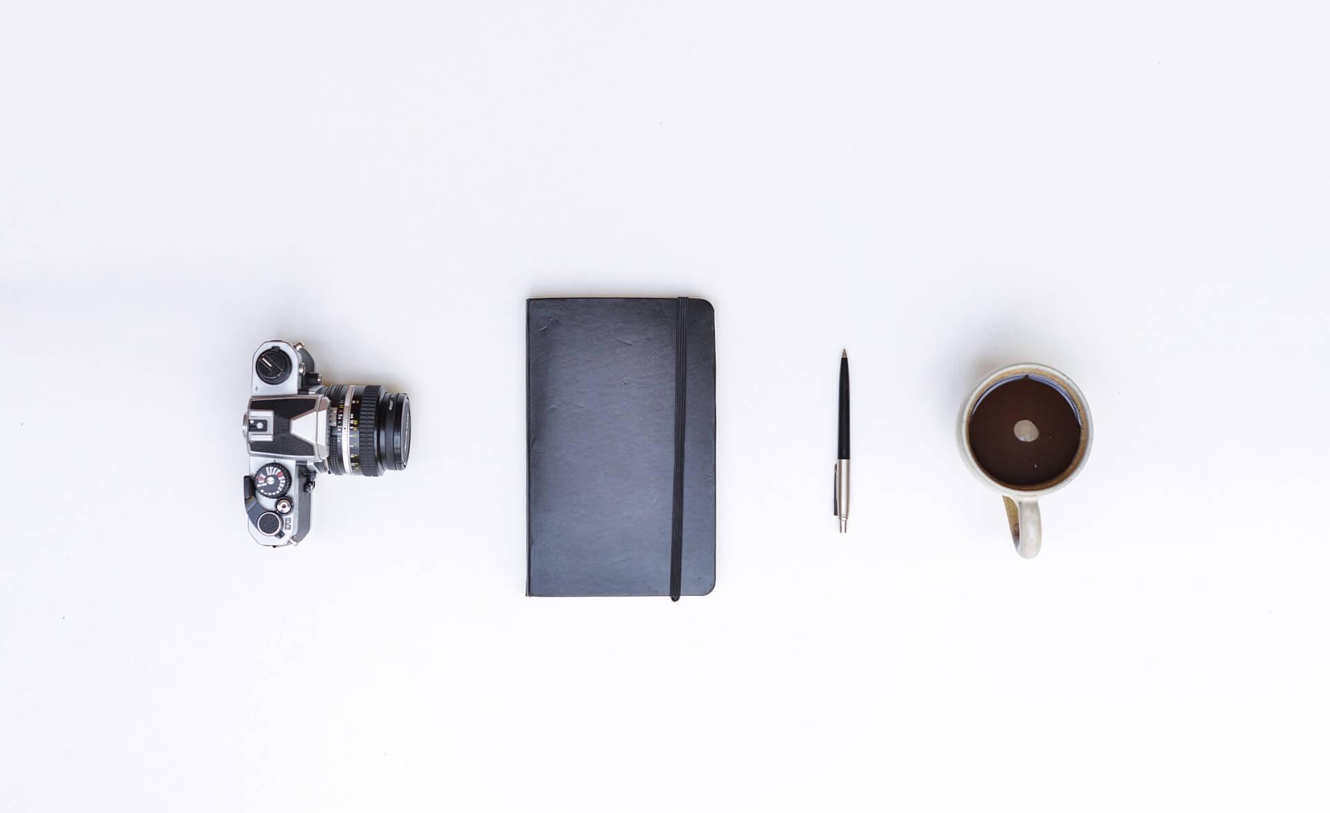 相机,笔记本,笔,咖啡